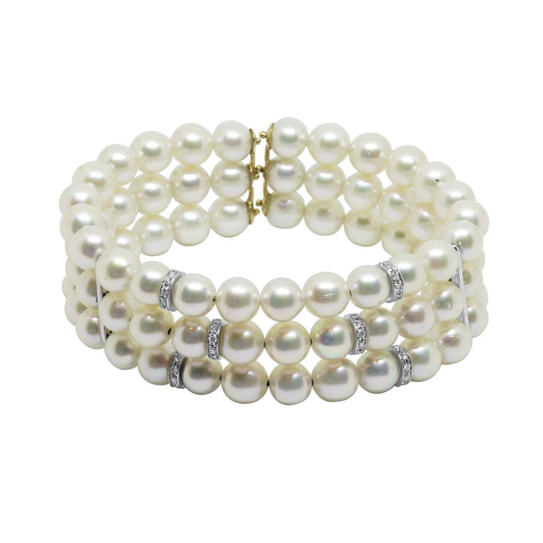 Bracciale rigido con tre fili di perle, inserti con diamanti - ORO&CO