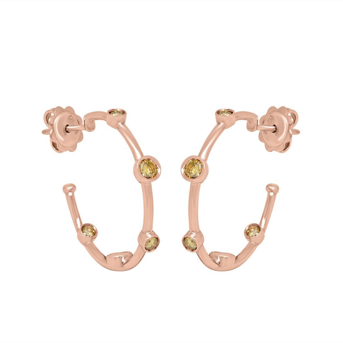 Orecchini in oro rosa e diamanti ct. 0,40 - DAMIANI