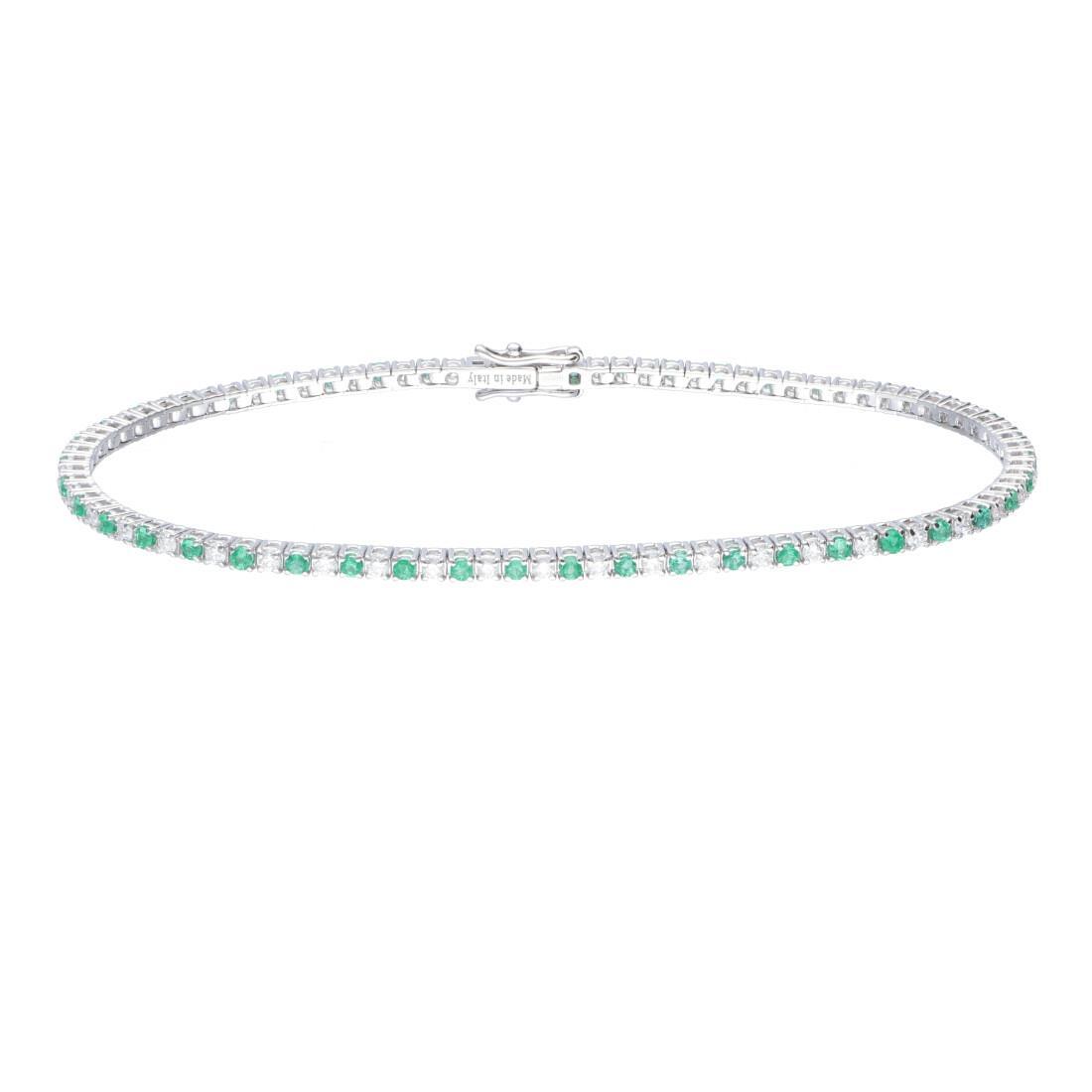 Bracciale tennis in oro bianco con diamanti e smeraldi - ALFIERI ST JOHN